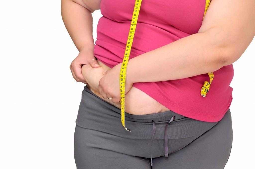 grasa en cuerpo de mujer